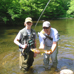 Rob and a young student with his first trout.