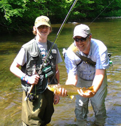 Miles' first trout with instructor Rob Fightmaster.