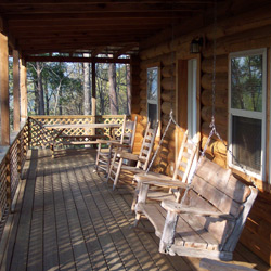 Front porch with rocking chairs and a swing