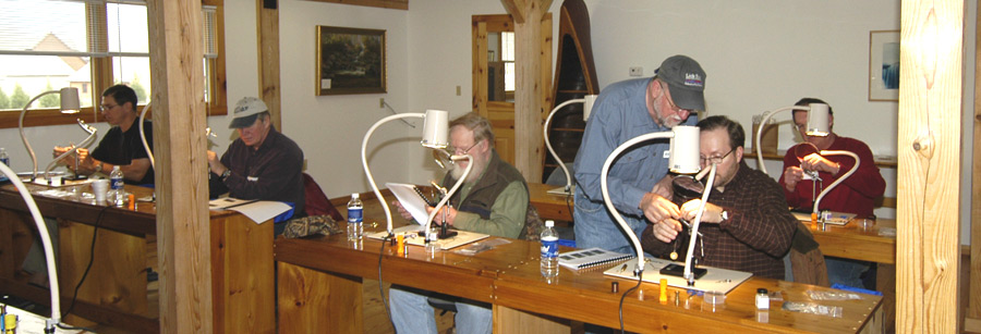 Fly tying students and instructor in our classroom.