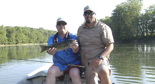 Frank Brown and guide Josh Pfeiffer with a large smallmouth bass Frank caught.