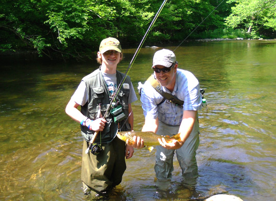Miles and Rob with a big brown trout.