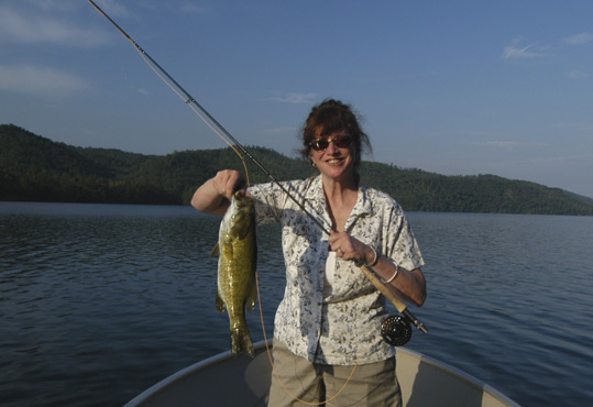 Paula Begley with a large smallmouth bass she caught on June 12, 2013 while fly fishing near Townsend, Tennessee