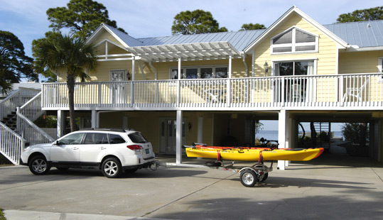2014 Subaru Outback with trailered kayaks.