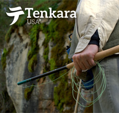 Fisherman holding a collapsed Tenkara Rod and Fly Line